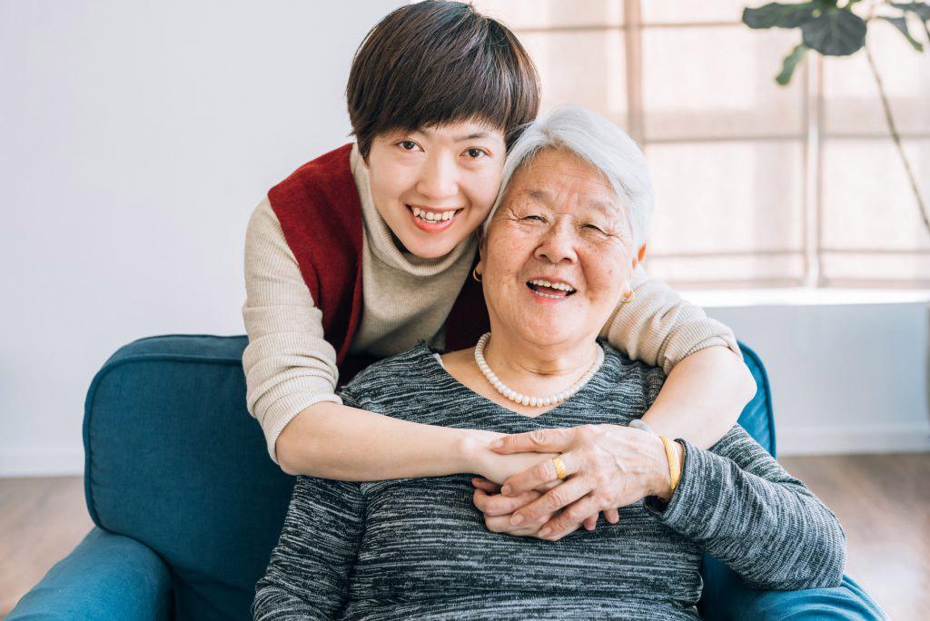 Girl and senior woman smiling