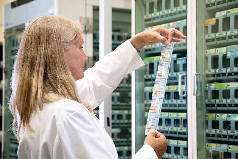 A female pharmacist examining a medication strip